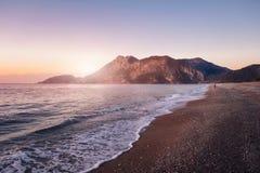 Cirali coastline with mountains at sunrise stock image