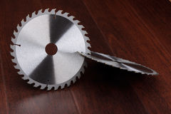Circ saw blades on dark background stock image