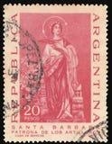 Circa 1967 van Argentinië: Geannuleerde die postzegel door Argentijnse munt wordt gedrukt, die de patrones van heilige Barbara va stock foto's