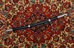 Circassian cavalry sword  in a sheath on the carpet Stock Images