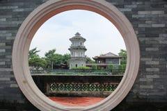 Circle arch door, Chinese jiangnan garden. Circle arch door and lotus pond, Chinese jiangnan garden Stock Image