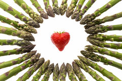 Circle Of Asparagus Tips Pointing At Strawberry Royalty Free Stock Photos