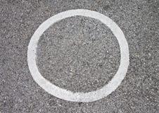 Circle on the asphalt. Stock Photos