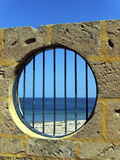 Circle bars. Circular window overlooking the beach Stock Photo