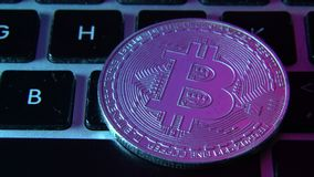 Circle Bitcoin coin on top of computer keyboard buttons. Digital currency, block chain market, online business.  stock video