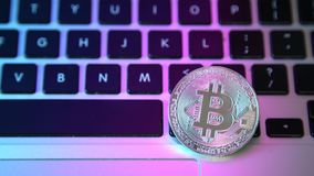 Circle Bitcoin coin on top of computer keyboard buttons. Digital currency, block chain market, online business.  stock footage