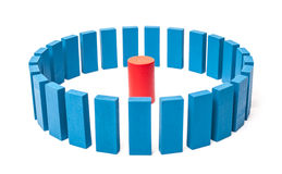 Circle of blue blocks around single red one Royalty Free Stock Photography