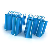Circle of blue shopping bags Stock Photos