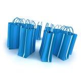 Circle of blue shopping bags Stock Photos