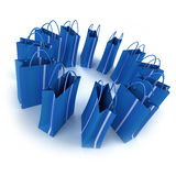 Circle of blue shopping bags Royalty Free Stock Images