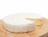 Circle Brie  cheese on wooden desk isolated Royalty Free Stock Photo