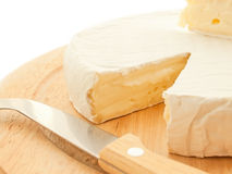 Circle Brie  cheese on wooden desk with knife Royalty Free Stock Photo