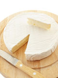 Circle Brie  cheese on wooden desk with knife Royalty Free Stock Images