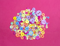 Circle of brightly coloured different buttons. Collection of a range of different coloured buttons for a poster or web background Stock Image