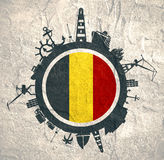 Circle with cargo port and travel relative silhouettes. Belgium flag. Circle with sea shipping and travel relative silhouettes. Concrete texture. Objects royalty free stock photo