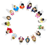 Circle of Cheerful Children playing Stock Image