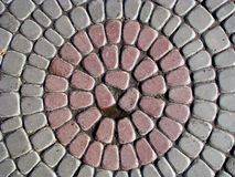 Circle cobbles. Background with gray and pale red stones Stock Photography