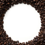 Coffee beans frame. Circle coffee beans frame with copy space, isolated on white background. Top view Royalty Free Stock Image