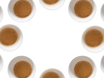 Circle of coffee. Multiple cups od coffee on white background Royalty Free Stock Photos