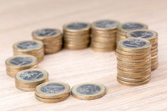 Circle of coins increasing in size Stock Photo