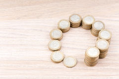Circle of coins increasing in size Stock Image