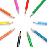 Circle of colored pencils. On white stock photography