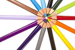Circle of colored pencils. Colorful wooden pencils on a white background Stock Images