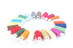 Circle of colorful threads on a white Royalty Free Stock Images