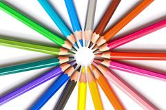Circle of colorful wooden pencils isolated on white Stock Images