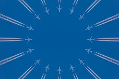 Circle of commercial airplanes against a blue sky Royalty Free Stock Photos