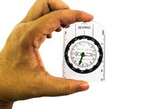 Circle Compass with transparent plastic plate in man hand. Isolated with white background Royalty Free Stock Images