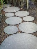 Circle concrete slab path. In the garden royalty free stock image