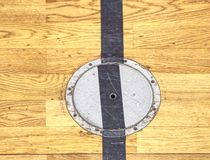 Circle cover plug for sport equipment in floor of school gym