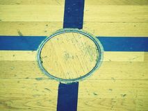 Circle cover for training equipment in floor of school gym. Painted lines Royalty Free Stock Photo