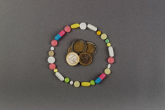 Circle created from colored pills with money. Medical concept Stock Images