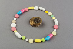 Circle created from colored pills with money. Medical concept Royalty Free Stock Image