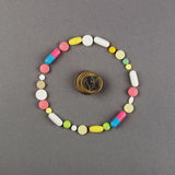 Circle created from colored pills with money. Medical concept Royalty Free Stock Photos