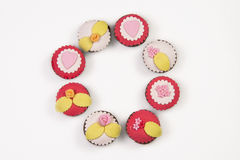Circle of   cupcakes. On white background Royalty Free Stock Images