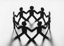 Circle of cut out paper figures (b&w) Royalty Free Stock Images