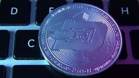 Circle Dash coin on top of computer keyboard buttons. Digital currency, block chain market, online business.  stock footage