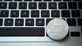 Circle Dash coin on top of computer keyboard buttons. Digital currency, block chain market, online business