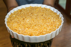 The circle dish of cracker crust in hand Stock Photography