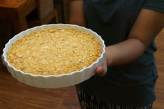 The circle dish of cracker crust in hand. The circle dish of cracker crust in women hand Stock Photo