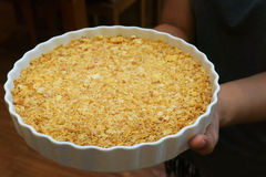 The circle dish of cracker crust in hand. The circle dish of cracker crust in women hand Stock Photos