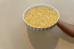 The circle dish of cracker crust. In women hand Royalty Free Stock Image