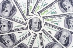 A circle of 100 dollar bills with a Franklin portrait in the center. Money background.  stock image