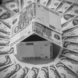 In the circle the dollar, a house made of Euro banknotes. House made of Euro banknotes, in a circle dollar Stock Photo