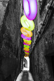 Circle donuts colorful perspective in a rock street Royalty Free Stock Photography