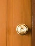 Circle door knob and  brown wood door. Circle door knob on closed brown wooden door Stock Photo