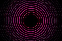 Circle dynamic bright pink cool round in dark. Background Royalty Free Stock Photos